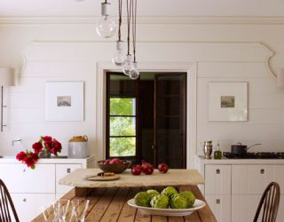 white kitchen with wooden farmhouse table