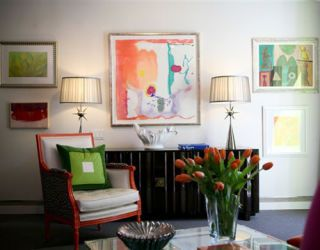 colorful and vibrant artwork hanging on one wall in eileen kathryn boyds living room design
