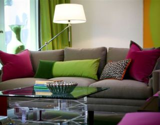 greyish sofa with colorful accent pillows in all different shapes and sizes