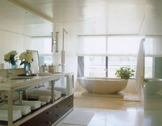 white bathroom with bathtub and shower
