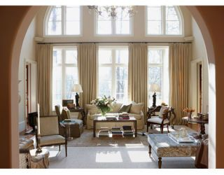 large living room with high ceilings and big windows