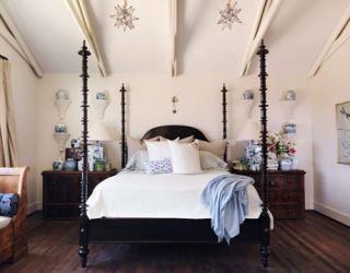 white bedroom with wall brackets