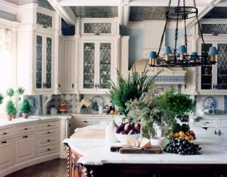 blue and white kitchen with chandelier