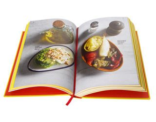 open cookbook with images of salads