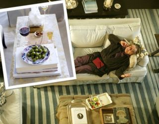jack nicholson laying on sofa with image of coffee table