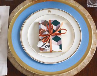 place setting dinner plate on top of charger