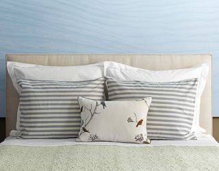 pillows on a bed lined up symmetrically