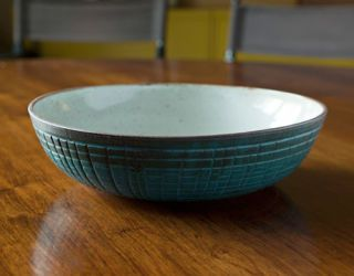 blue bowl on wood table