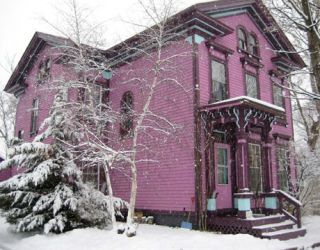 pink house with snow
