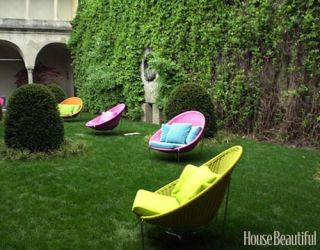 egg shape multi color chairs on a lawn