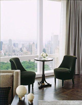 Green velvet chairs on a parquet  floor.