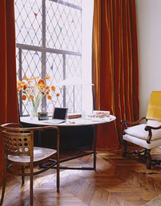 Orange curtains in Ina Garten's living room.