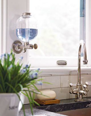 detail of white kitchen and faucet