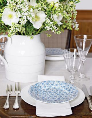 antique ironstone pitcher and blue and white plates