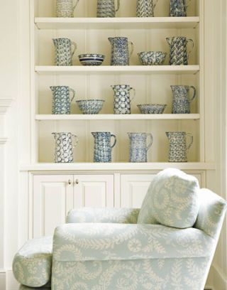 white shelves and blue chair with spongeware