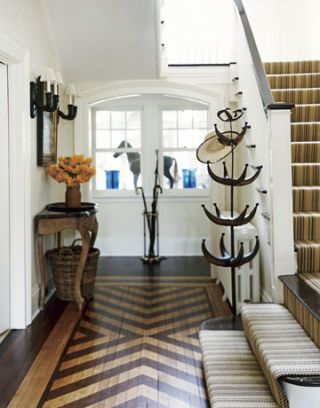 white foyer with patterned parquet floor