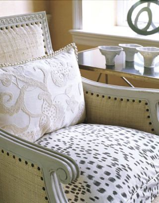 white chair with dalmatian print cushion