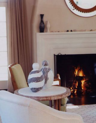 white and black vases in front of fireplace