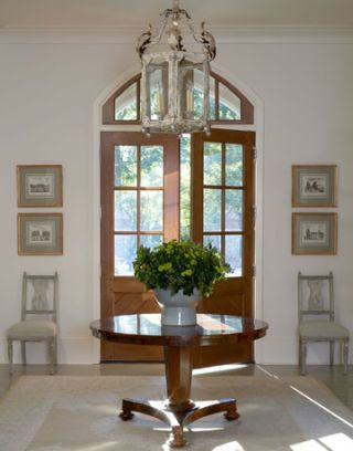 entry hall with table in atlanta house designed by suzanne kasler