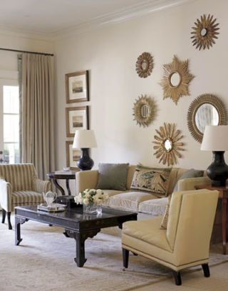 white living room with starburst mirrors