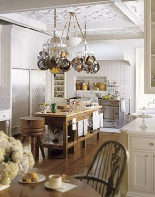 kitchen with cast plaster motif on ceiling and antique butcher block