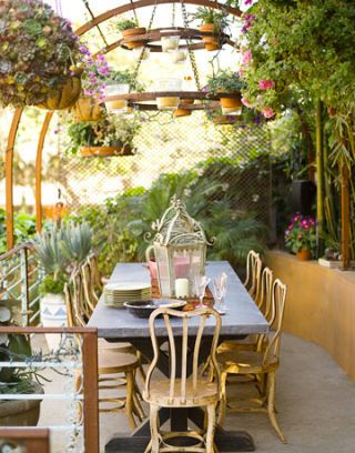 outdoor antique table chairs and chandelier