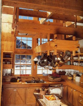 wooden rafters in a bright kitchen with big windows