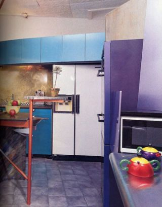 brightly colored modern kitchen with counter and refrigerator