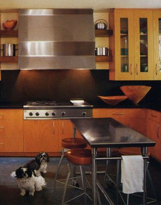 stained wood cabinets, stainless steel range and rangehood