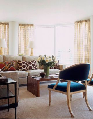 To avoid blocking the sensational city views, furniture in the living room--including Gustavian chairs covered in inky mohair velvet--steers well clear of the floor-to-ceiling windows.