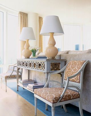To match the owner's neoclassical-style Cohler paired these chairs, with a table and lamps.