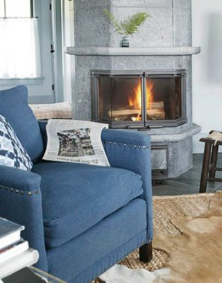 a blue denim chair by the fireplace