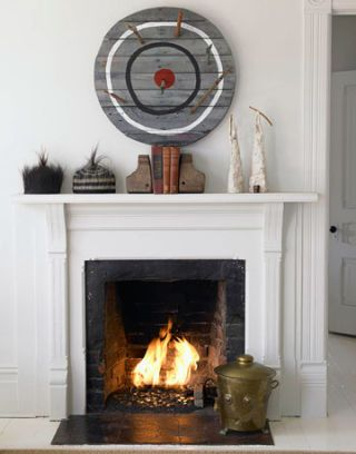 fireplace with artwork surrounding it