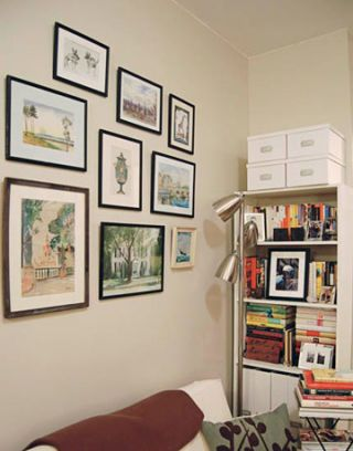 white wall with vintage artwork