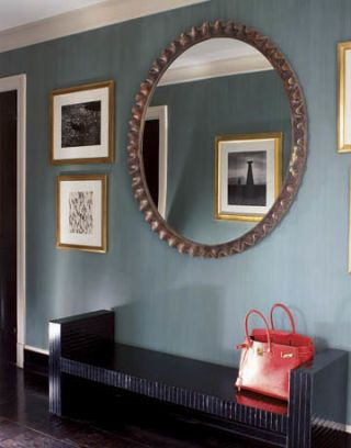 entryway with bench and mirror hanging on the wall