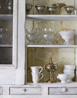 white cupboards with dishes