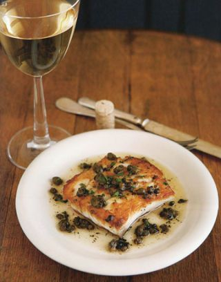 grouper with lemon and caper sauce and a glass of wine