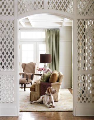 living room with lattice archway