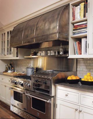 commercial grade stove and hood in a kitchen