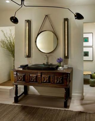 a bathroom sink surrounded by a modern mirror vanity lights and an overhead light fixture