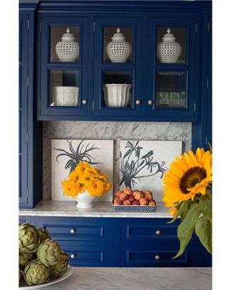 blue storage cabinet with white ginger jars