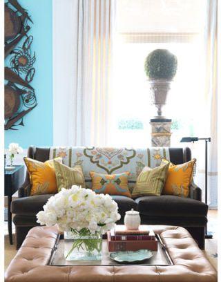 sofa sitting behind ottoman