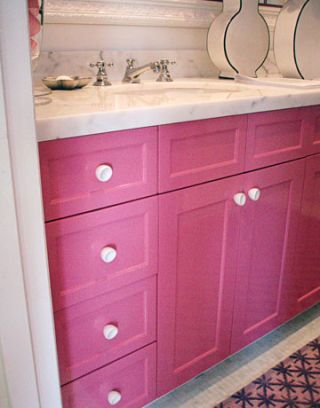vanity with bright pink drawers and doors