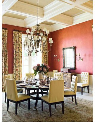 dining room with floral patterns and light red walls