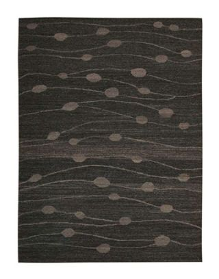 dark gray rug with abstract lines and dots pattern