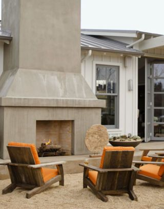 outdoor chairs around a fireplace