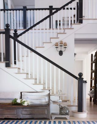 stairway in entryway with black banister