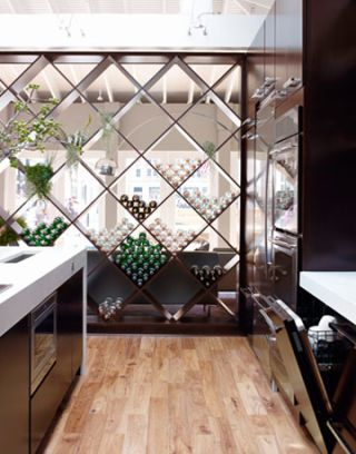 view of the room dividing wine rack in the kitchen of the year
