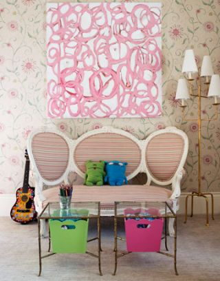 girls bedroom with pink scribble art and love seat with glass coffee tables