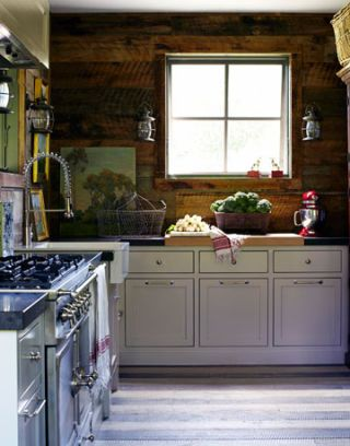 corner of kitchen with stove sink and window